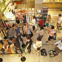 320px-Waiting_in_line_at_a_food_store-210x210