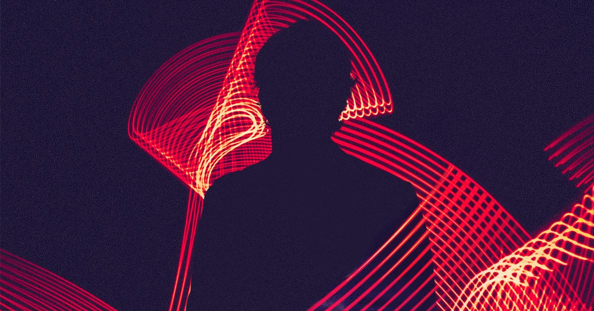 silhouette of a man in abstract lights