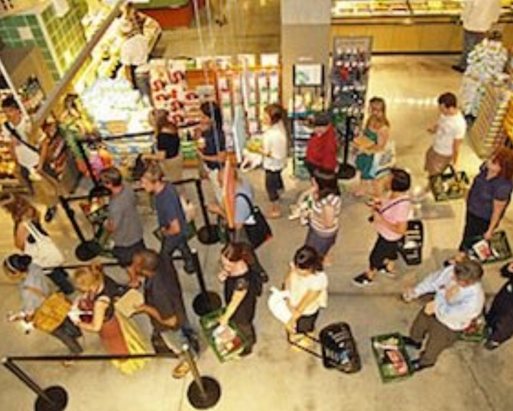 320px-Waiting_in_line_at_a_food_store-951097-edited.jpg