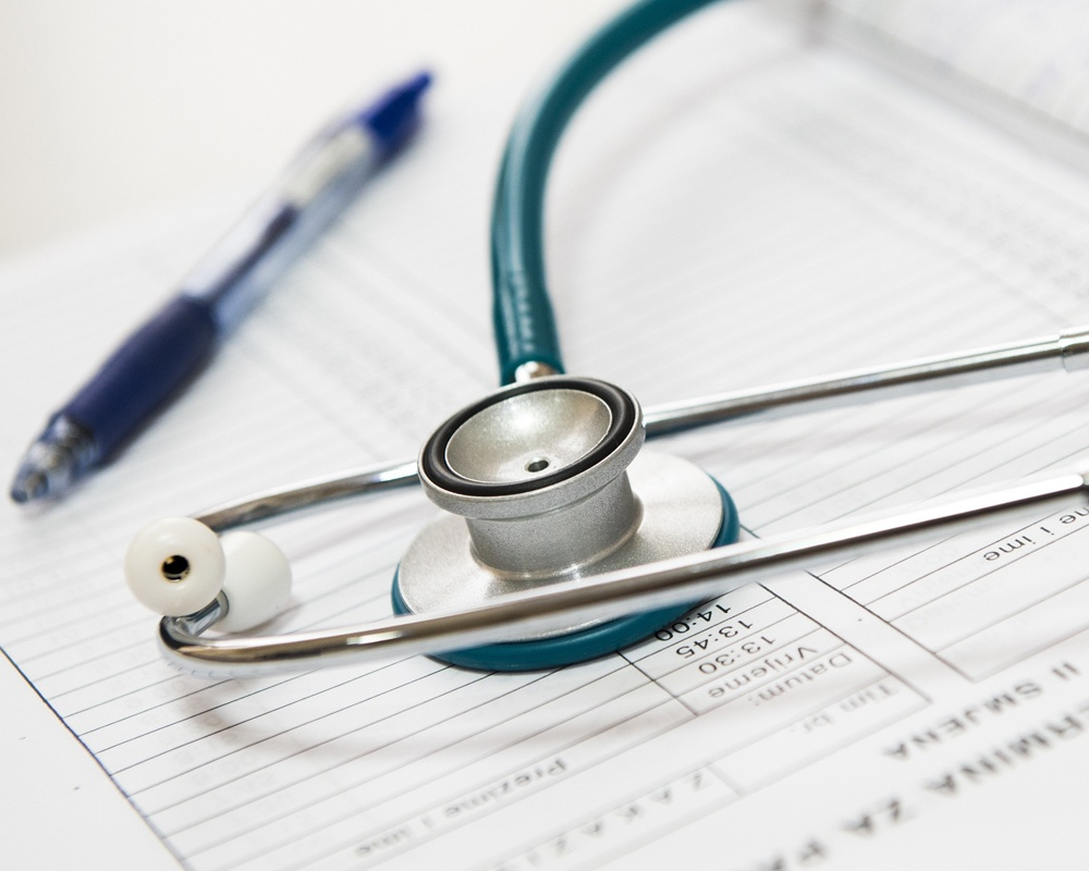 Stethoscope on medical records