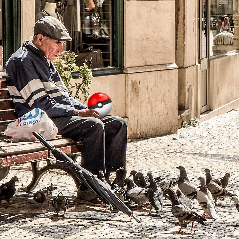 Old man surrounded by birds with a Pokemon Go bubble