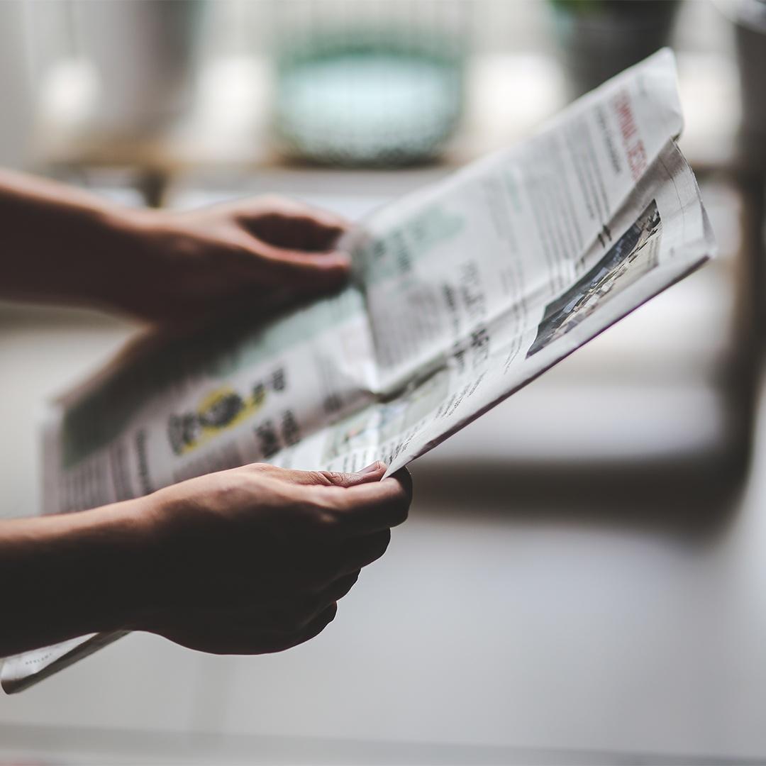kaboompics.com_Man_reading_newspaper_copy.jpg