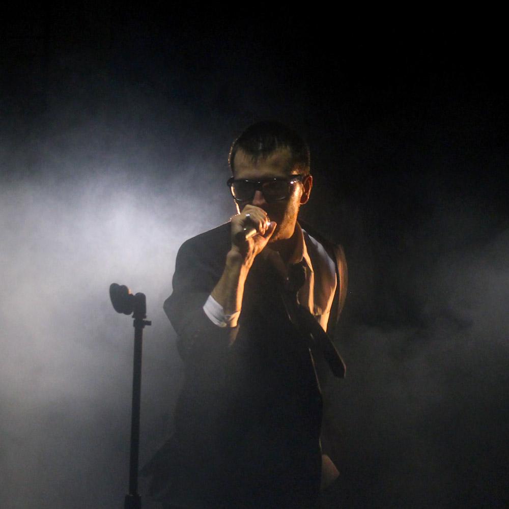 Man Speaking on Stage