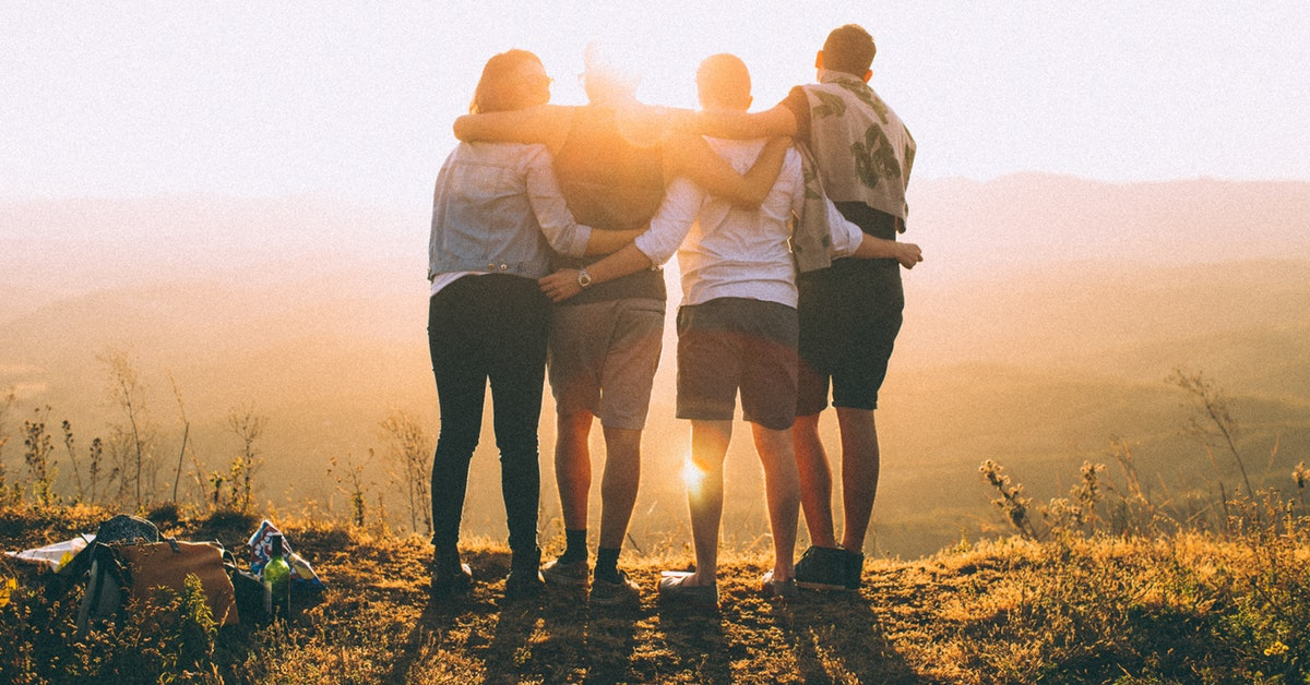A group of friends embracing
