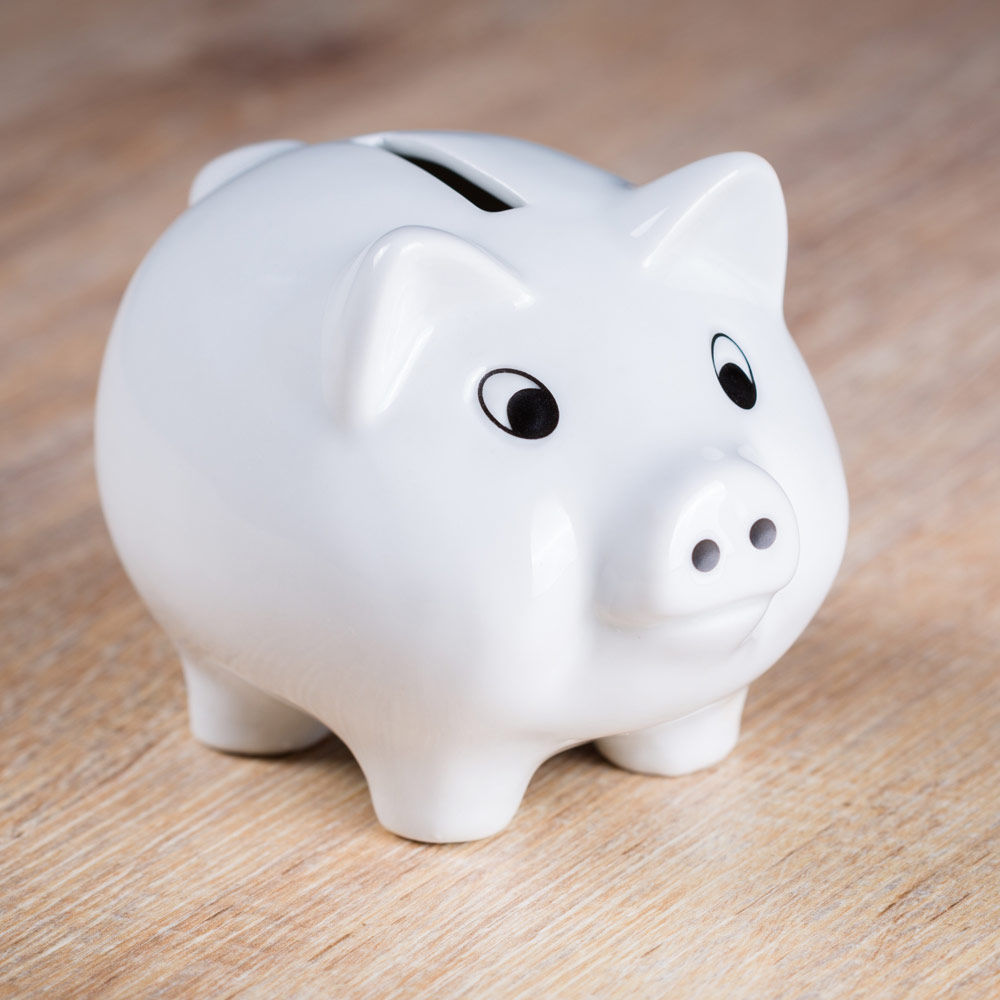 White piggy bank on table